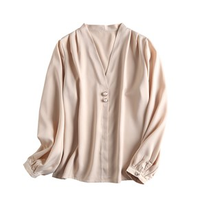 V NECK PEARL BUCKLE TOP